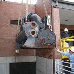 Existing chiller cut into sections and  extracted from the mechanical room